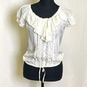 Totally flirty and comfy off-white blouse.